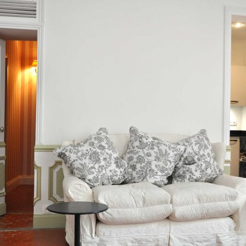 The comfy settee is an English import! The doors lead to the hall and the kitchen